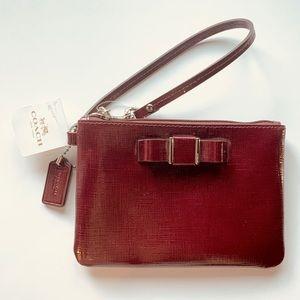 Coach• Sherry (burgundy) Darcy Patent Bow Wristlet